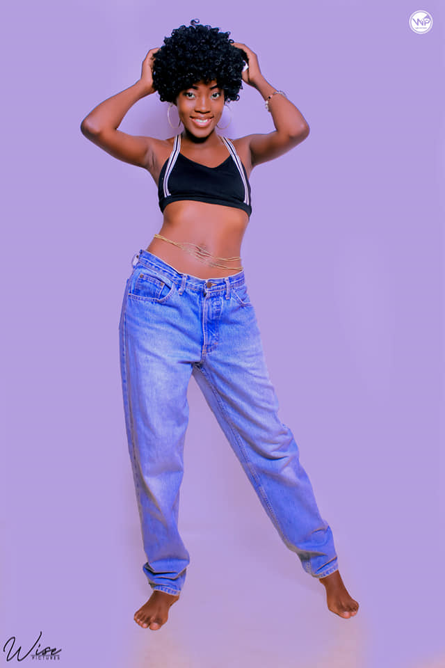 Candy Kambole Flaunts Abs in Retro Get up